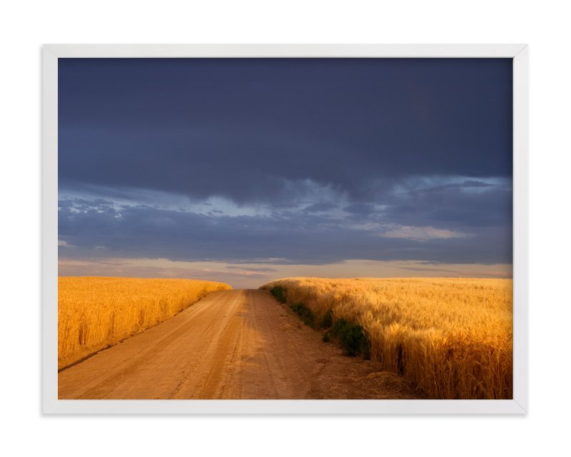 """Dirt Road Through a Wheat Field Under a Stormy Sky"" - Art Print by Kathy Van Torne in beautiful frame options and a variety of sizes."